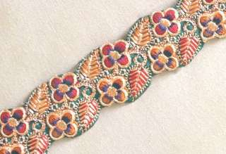 Trim with a floral design in satin stitch and chain stitch embroidery.