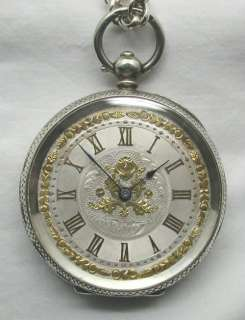 FANCY SILVER POCKET WATCH WITH GOLD & SILVER DIAL CHAIN & KEY