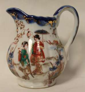Asian design figural pitcher/creamer