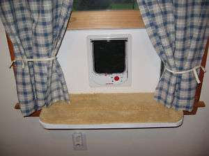 ELECTROMAGNETIC CAT DOOR WINDOW MOUNTED. CUSTOM SIZED